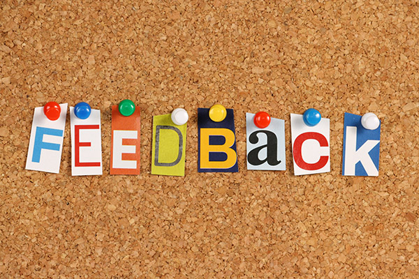 The word Feedback on a cork background